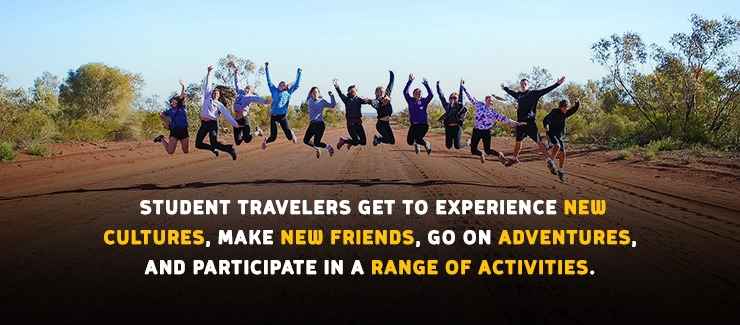 Student travelers jumping for joy in the Australian Outback