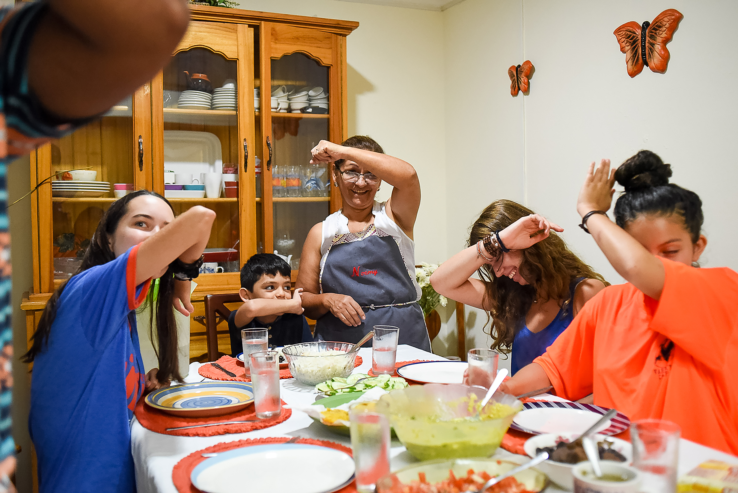 Students have some fun over dinner on Spanish Language Immersion in Costa Rica.