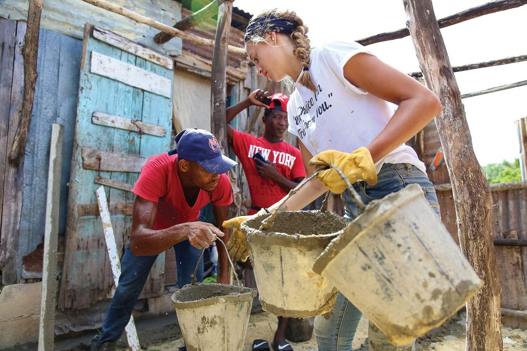assisting with home construction in Dominican bateyes