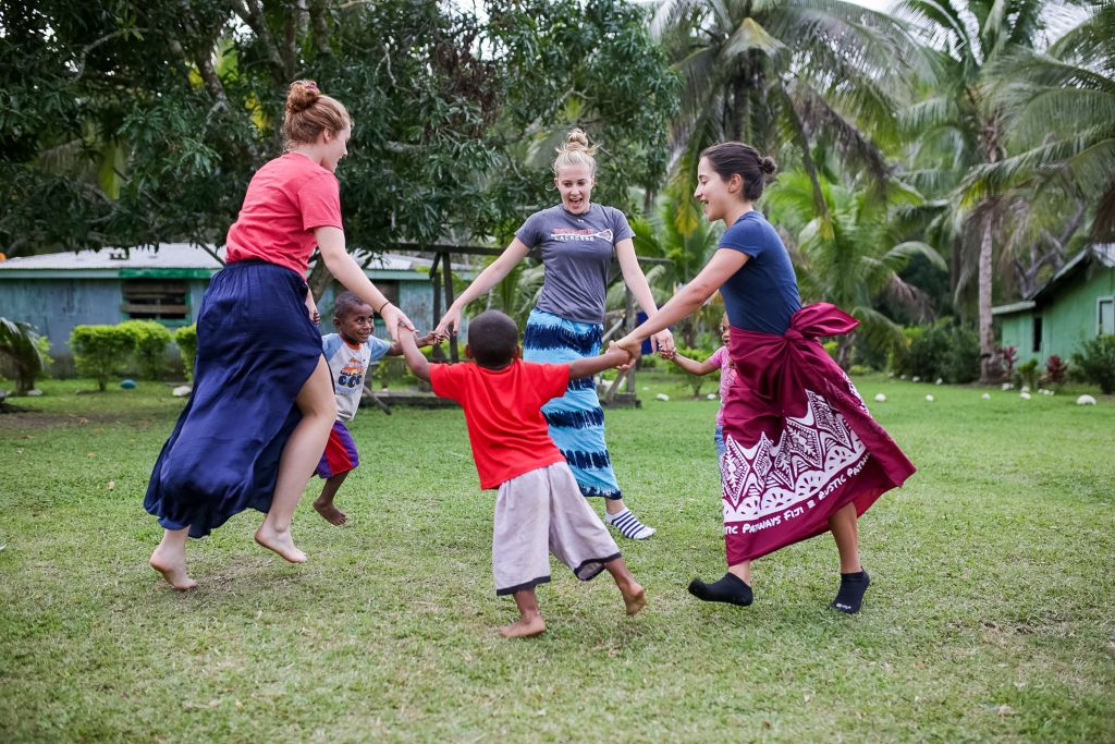 dancing with children in Fiji with Rustic Pathways
