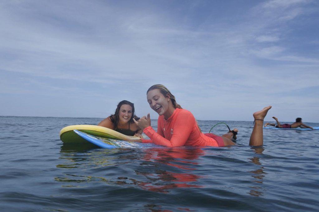 Anna Quinn surfing