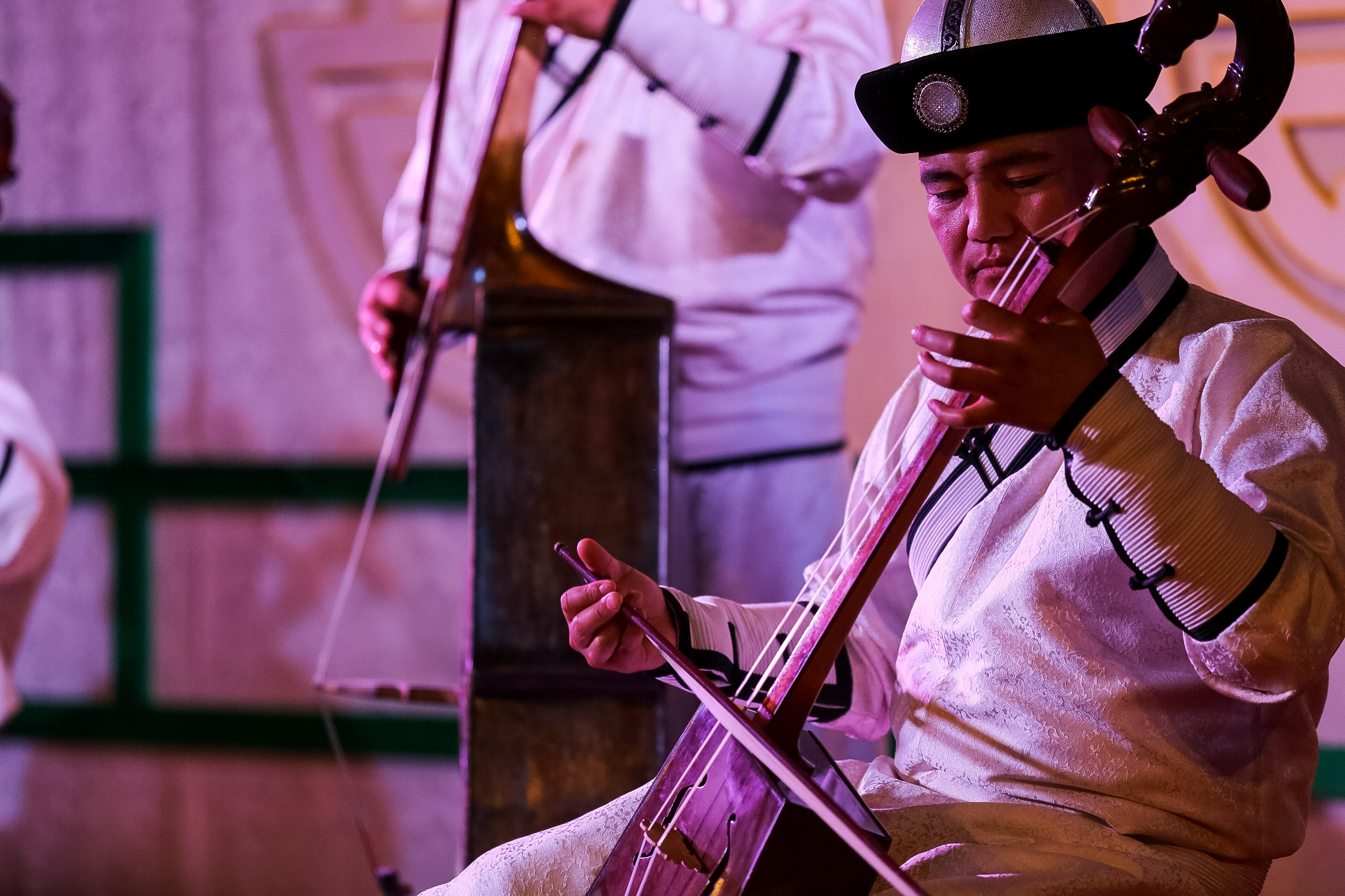musician plays morin khuur, or horse-head fiddle, in Mongolia