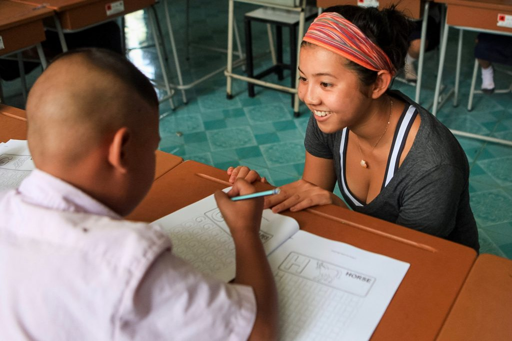 student volunteers in a classroom in Thailand