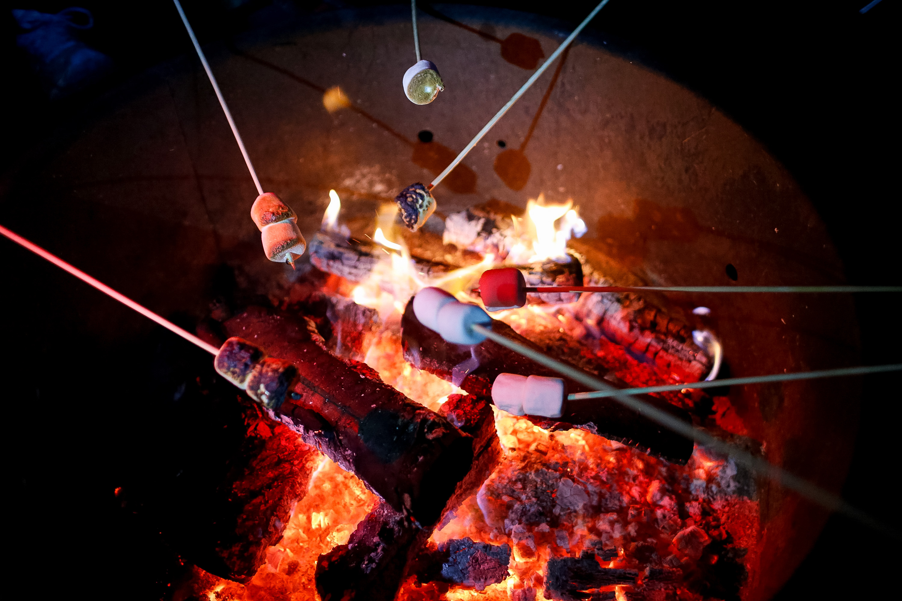 Roasting marshmallows over an open fire