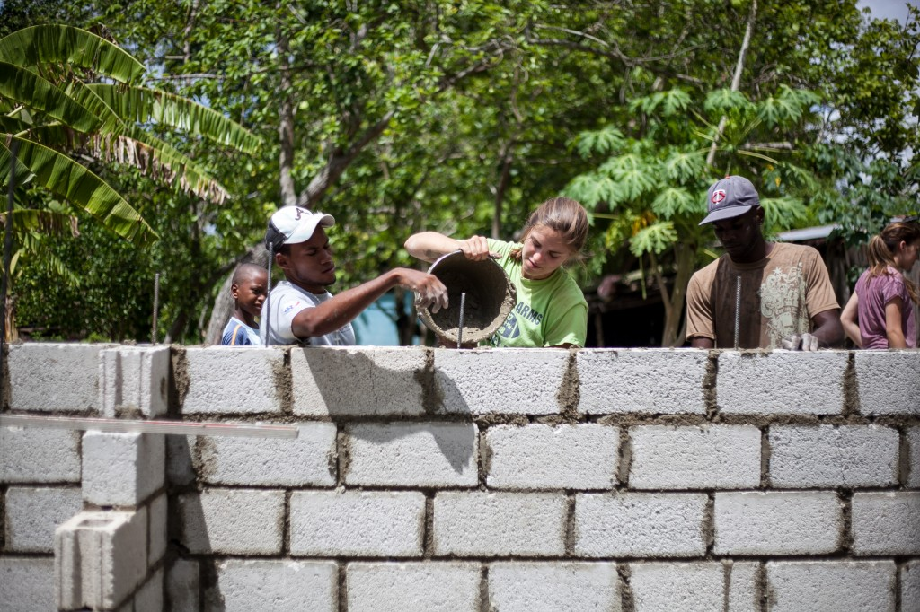 Community members and students working on a service project in the Dominican Republic